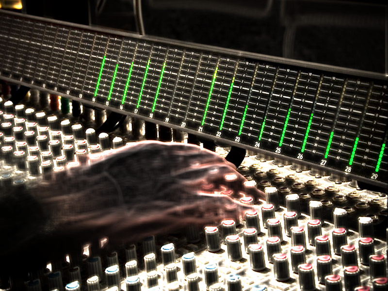 Studio engineer hands on mixing board