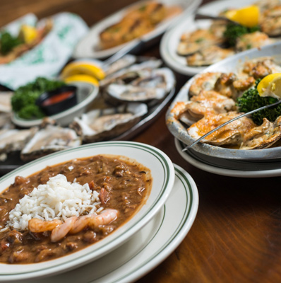 photo of several seafood dishes on a table